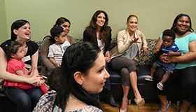 Lynda and Jennifer Lopez meet with mothers and children in Montefiore's Healthy Steps program.