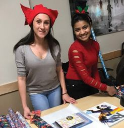 Santa's helpers wrap presents at the CHAM free shopping event for families.