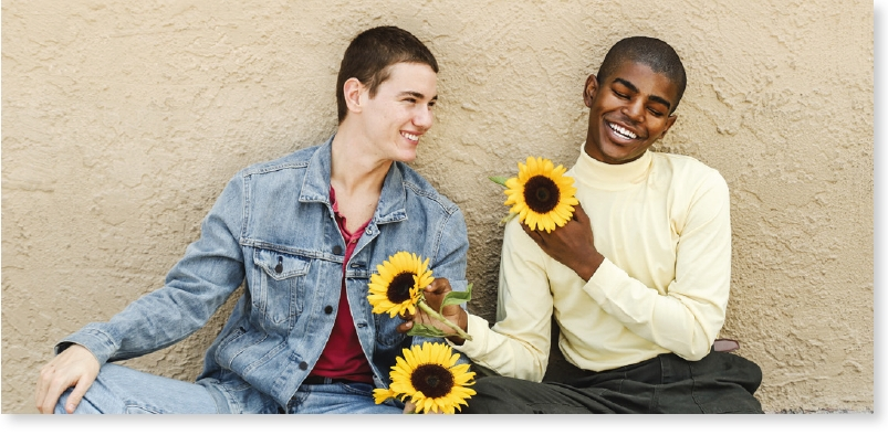 Two men with sunflowers